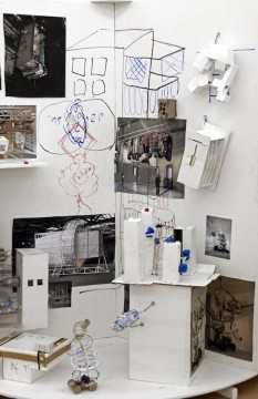 Die Walze, 2012 (Detail), Wooden construction with objects, paper, textile and a video 260 x 180 cm