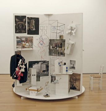 Die Walze, 2012, Wooden construction with objects, paper, textile and a video 260 x 180 cm